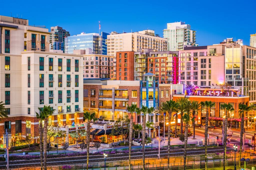 Cityscape of San Diego's Gaslamp Quarter with colorful buildings and palm trees