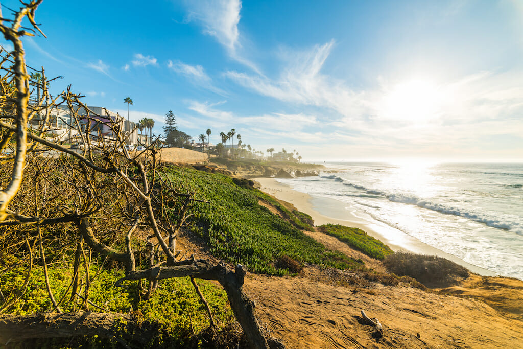 Sun shining over famous La Jolla beach at sunset. San Diego, California