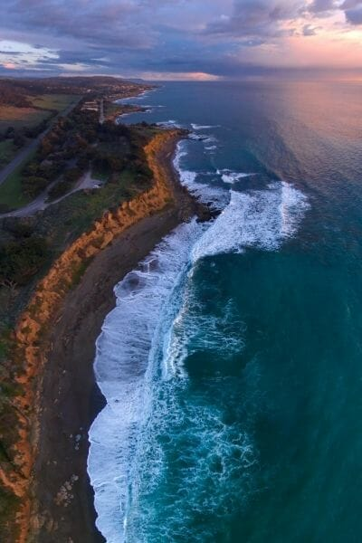 Drone shot of Southern California Coast line during sunset - Best San Diego Beach Resorts