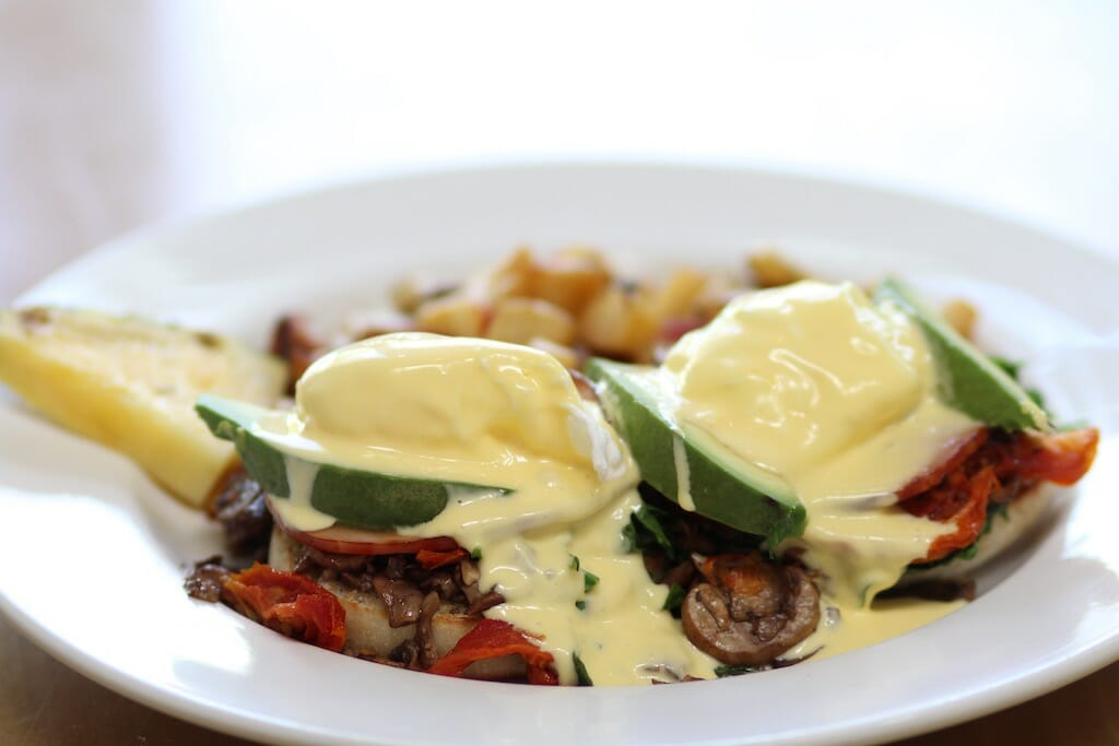 Beautiful hollandaise blanket over poached eggs, peppers and the rest of the mexican inspired eggs benedict