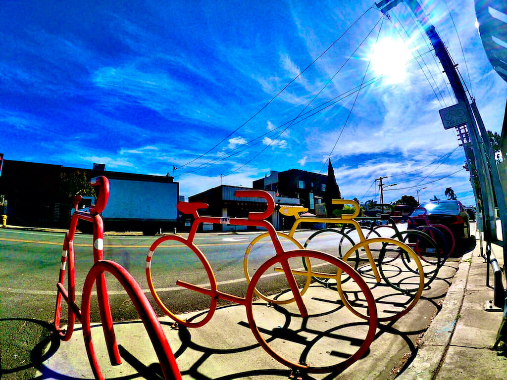 Rainbow bike-shaped bike stands stand out under the sun in beautiful Hillcrest, San Diego