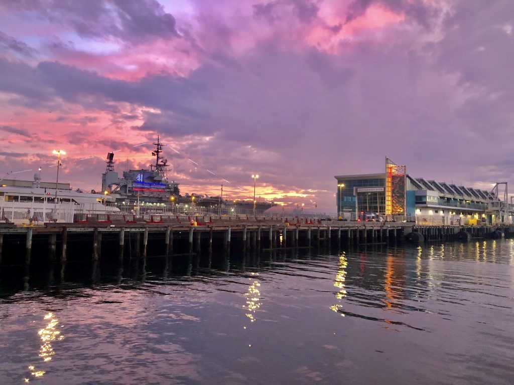 Broadway Pier San Diego at sunset with purple rain clouds