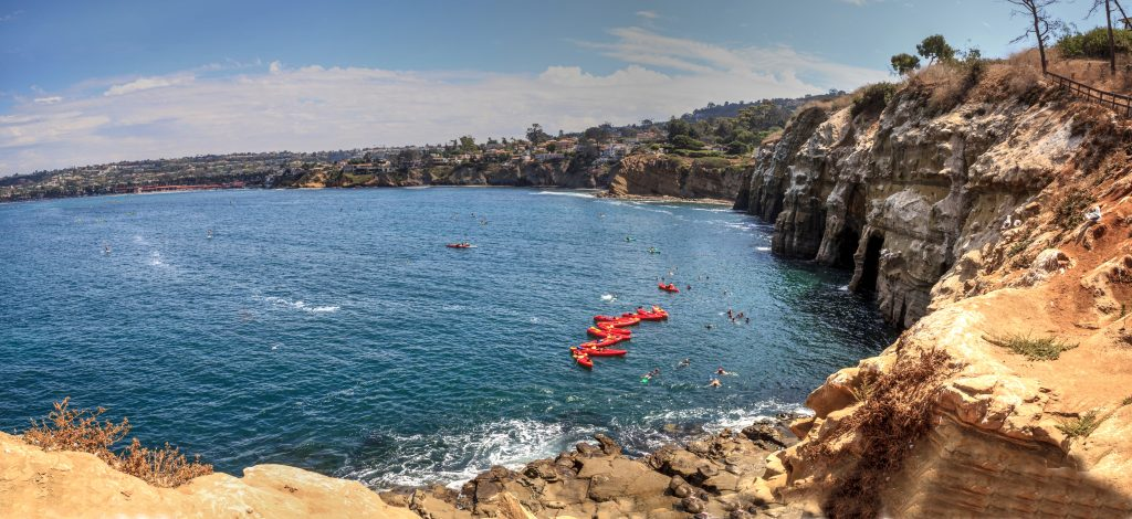 kayaks in the water near sand stone cliffs in La Jolla california - San Diego Valentine's Day