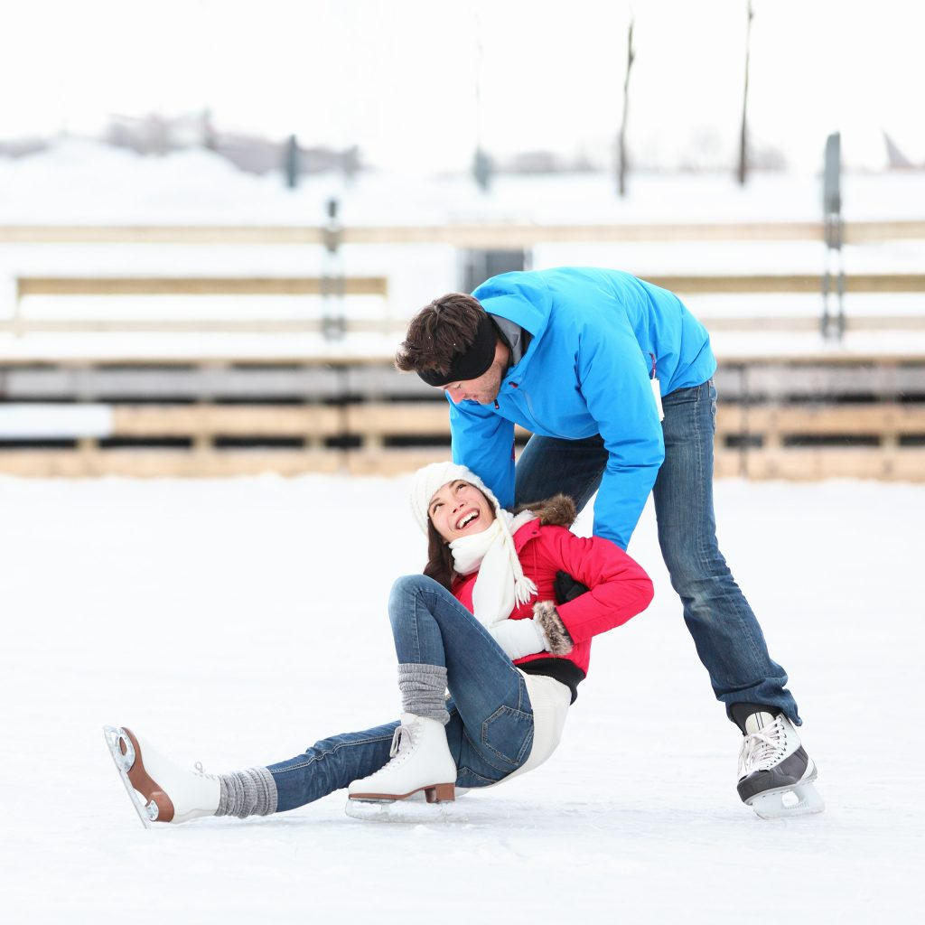 Ice skating couple having fun ice skating