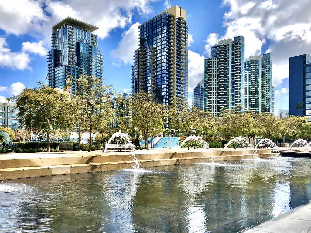 Fountain in the foreground with Highrise apartment buildings in the background at Waterfront Park San Diego Free things to do