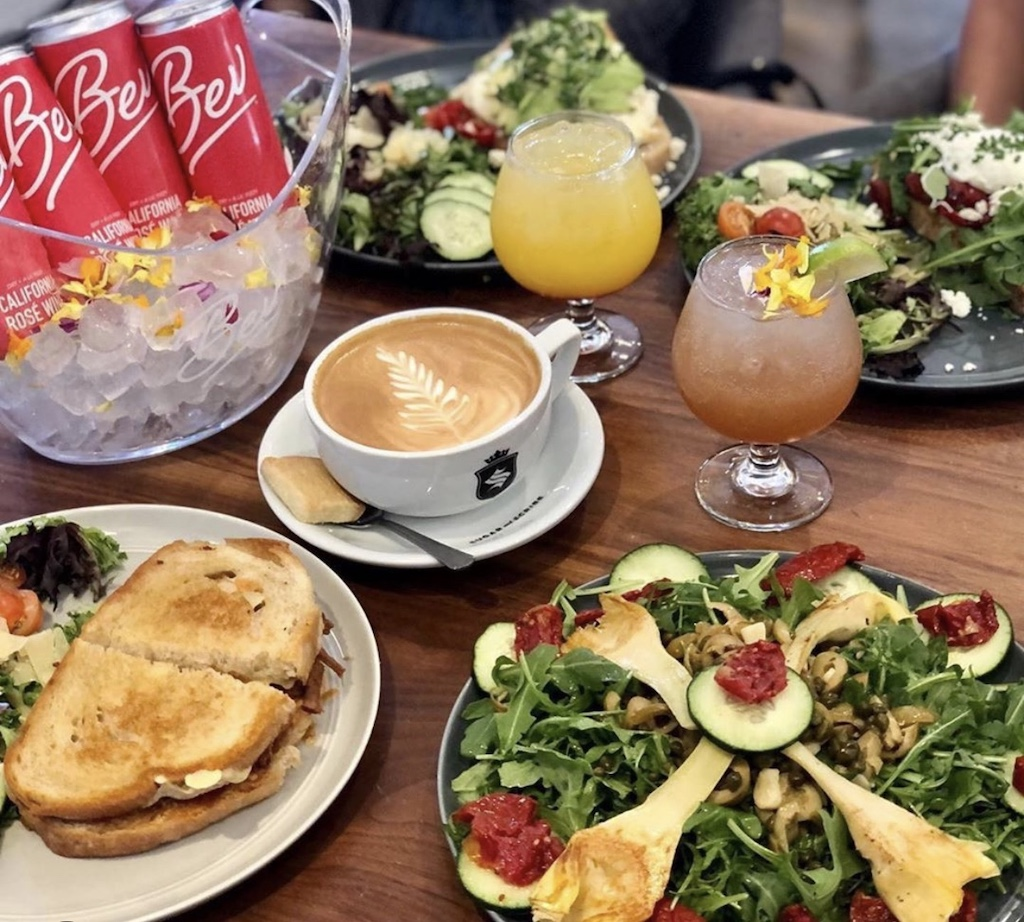 A table filled with brunch items and beverages, elegantly spread out on a table