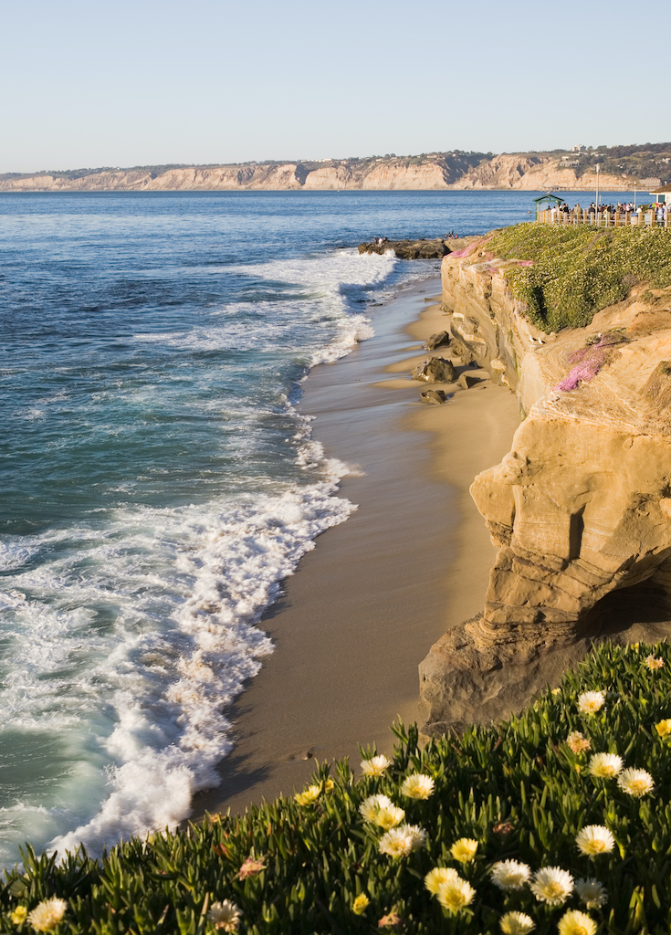 Beautiful cliffs, rocks, beach, and Pacific Ocean in La Jolla California in the late evening