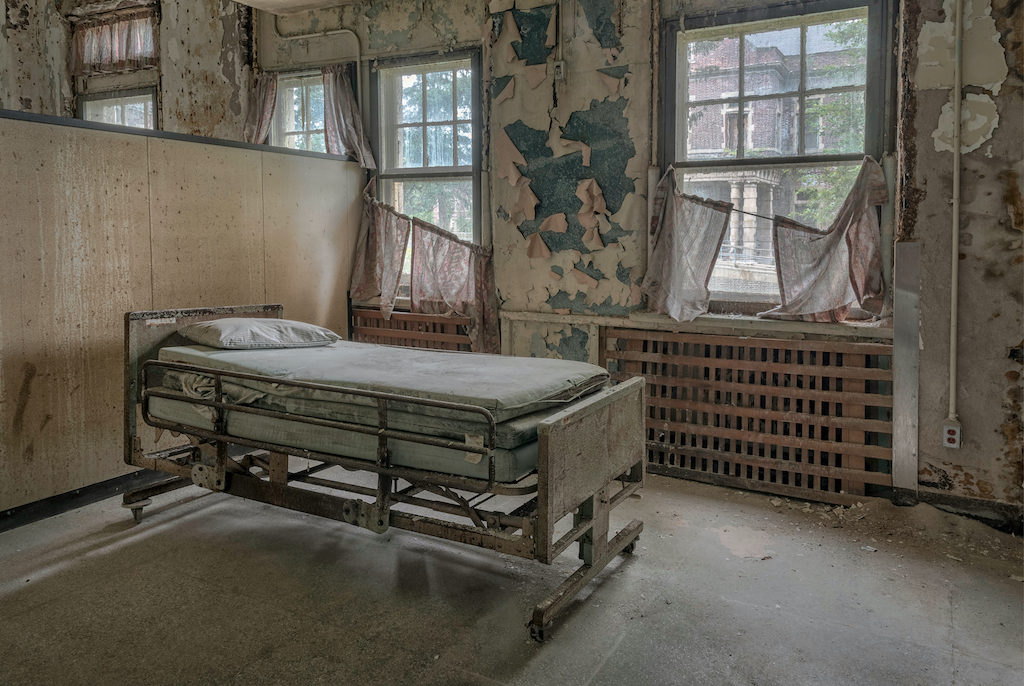 Hospital bed in an abandoned insane asylum