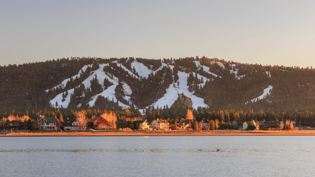 Big Bear Lake California in the winter with snow on the slopes at sunset