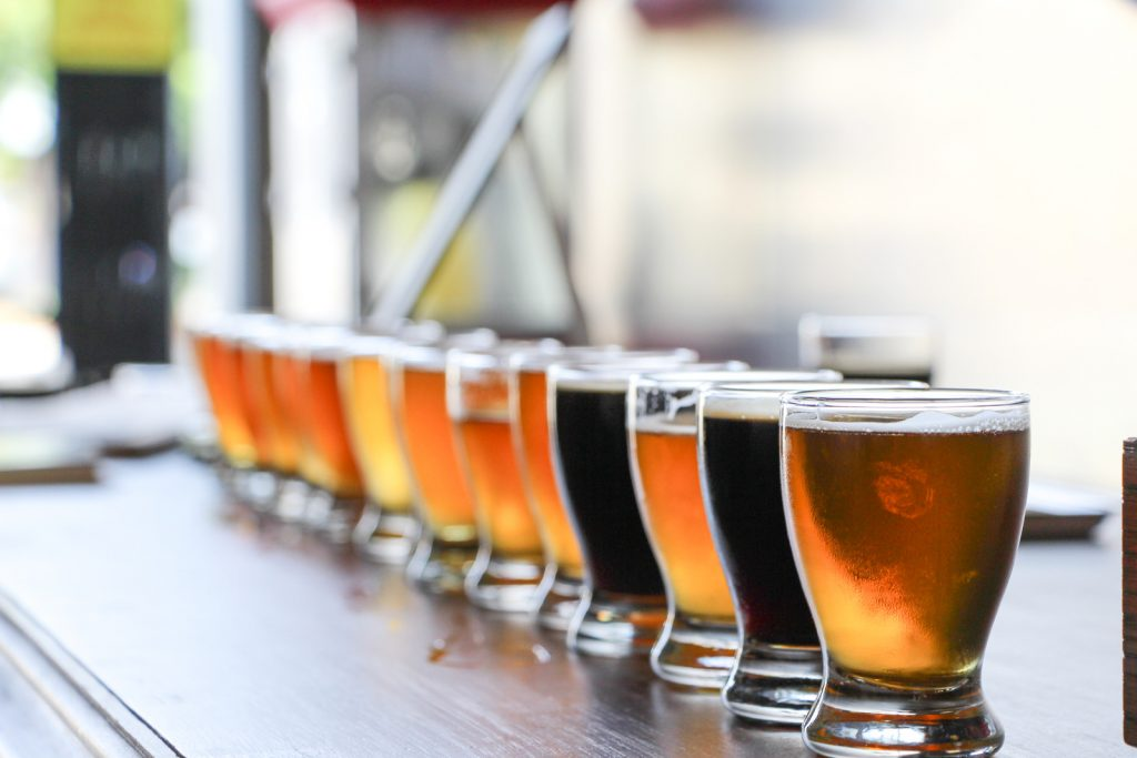 Flight of craft beer in various colors on a table