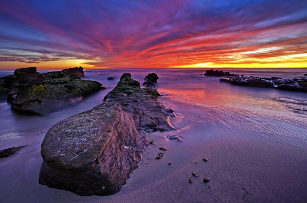 Amazing sunset lights up Windansea Beach in La Jolla, San Diego, California