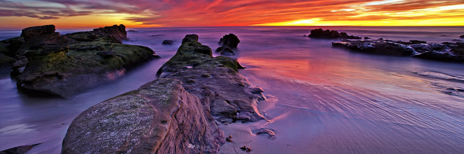 Amazing sunset lights up Windansea Beach in La Jolla, San Diego, California