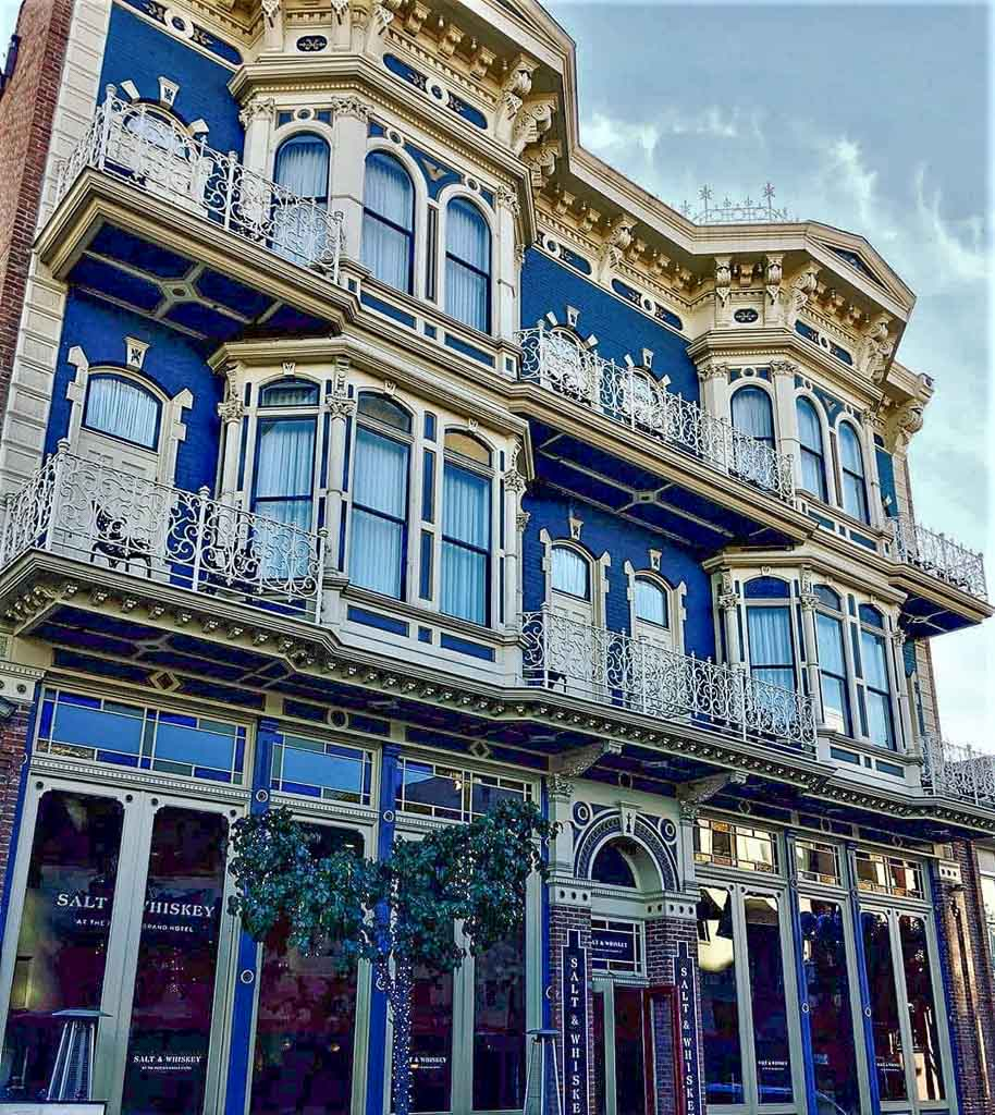 Facade of Horton Grand Hotel in San Diego - Victorian style building with white stucco and blue paint