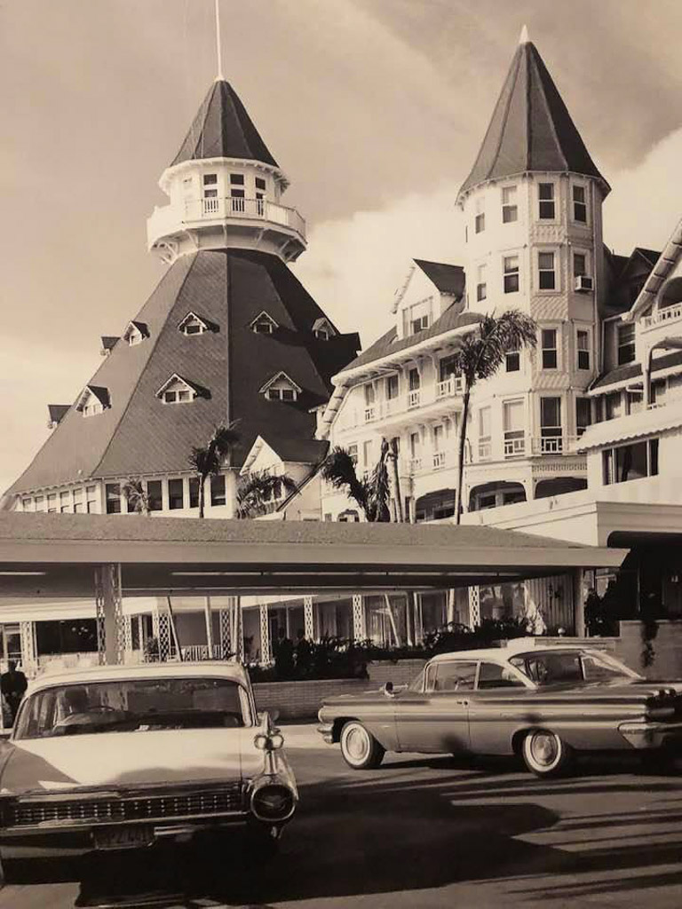 Vintage photograph of Hotel del Coronado with 1950s cars in the foreground