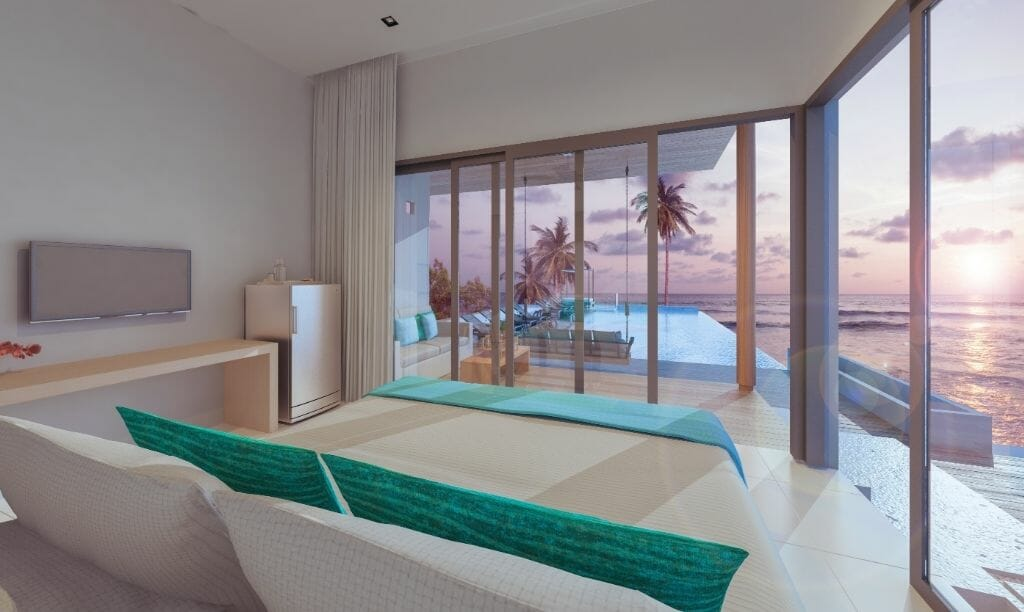 Mid-century modern furnished living room with large window front looking out to an infinity pool and the ocean