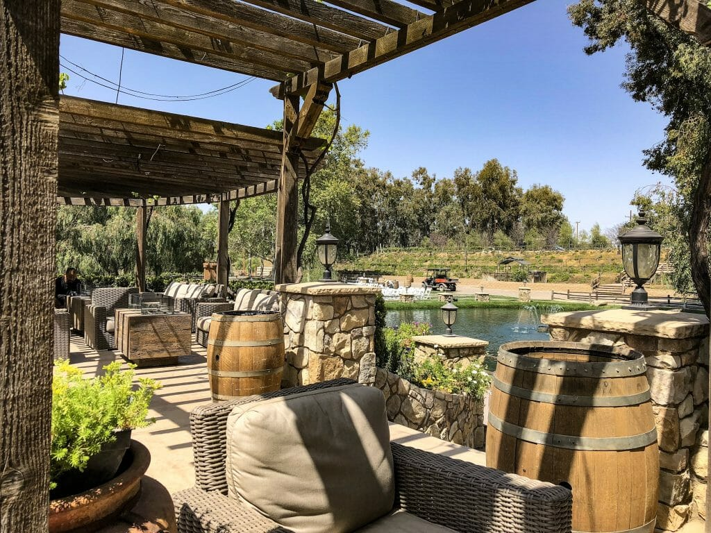 covered landscaped seating area at Vitagliano winery Temecula - Things to do in Temecula