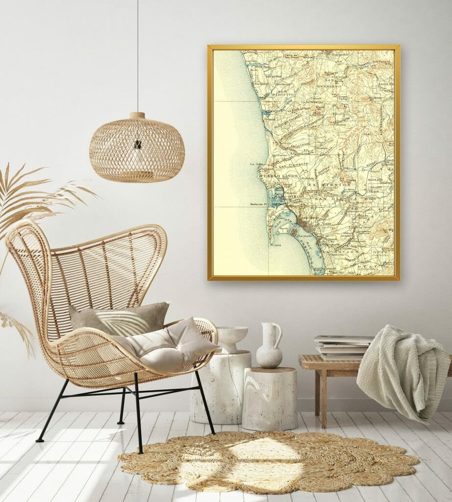 Living room with wicker furniture and vintage map of San Diego on a white wall