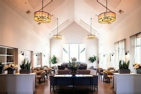 Indoor tasting room at Bottaia Winery with modern furniture and white walls