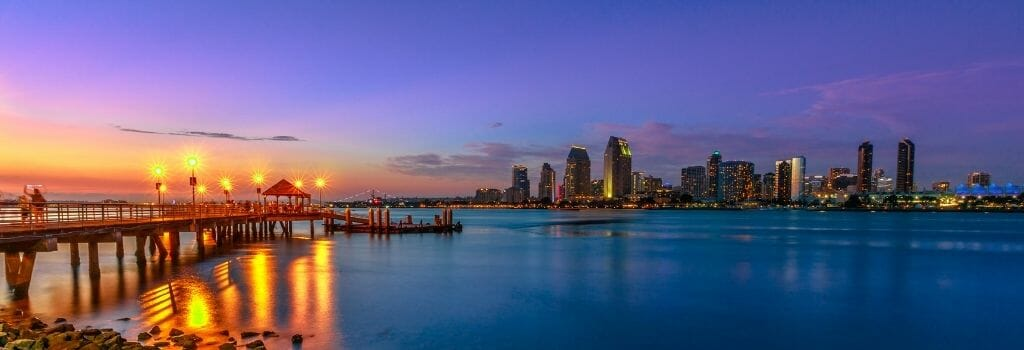 View of San Diego Skyline during sunset with wood pier