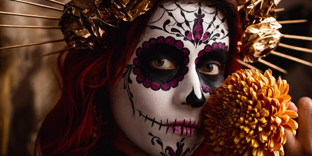 Woman with traditional Dia de Los Muertes Sugar Skull Makeup