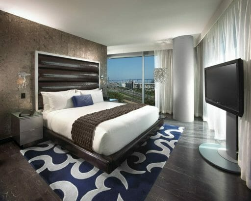 Hotel Room at the San Diego Hard Rock Hotel with a bed, TV and window overlooking downtown