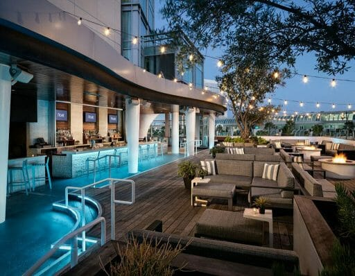 roof top bar at Hard Rock Hotel San Diego Gaslamp with bar and outdoor seating arrangements