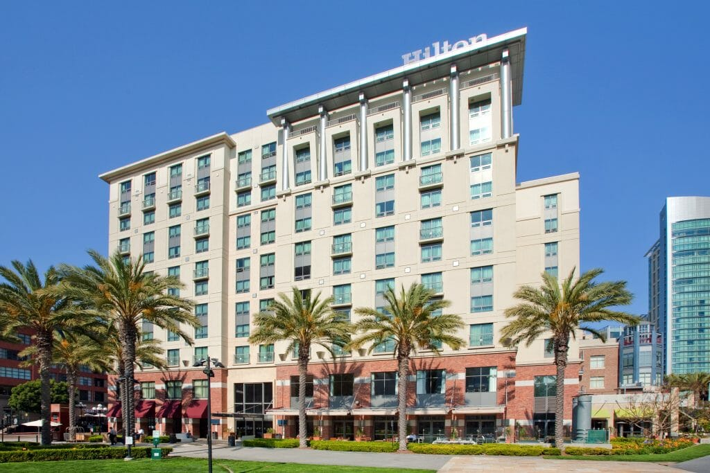 Hilton hotel in the Gaslamp Quarter, San Diego. White building with palm trees in front