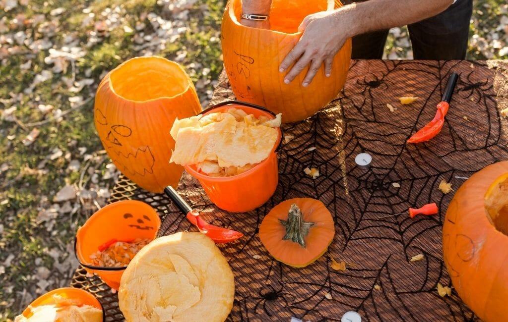 Pumpkin Carving Tabel with half finished carved pumpkins