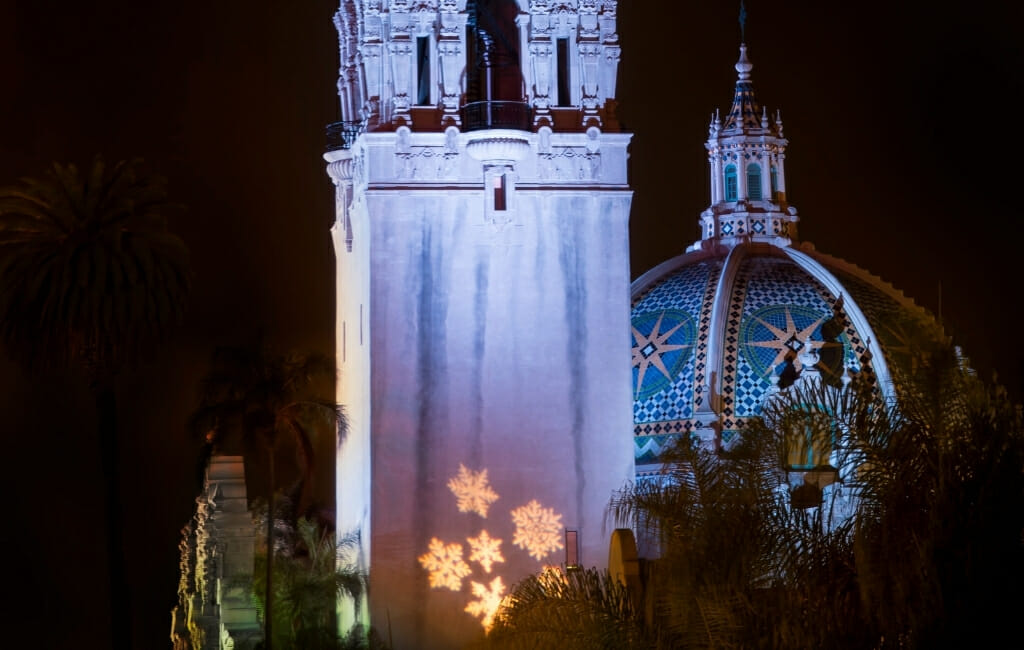 Snow flakes projected on Tower and dome of the Museum of US during San Diego December Nights in Balboa Park