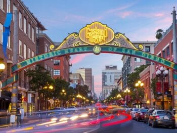 Decorative and lid up street sign over 5th avenue in the Gaslamp Quarter San Diego