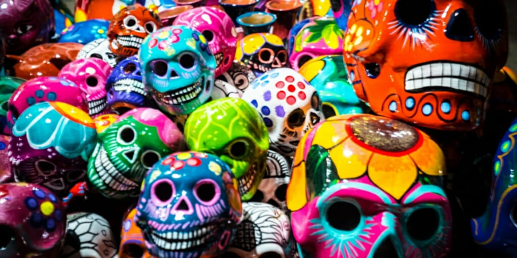 Decorative skulls in various colors decorated as a day of the dead tradition