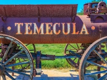 Historic, rusty railway cart with Temecula etched into the side