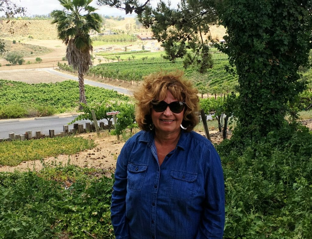 Author Noreen Kompanik standing in front of Hart Family winery in Temecula