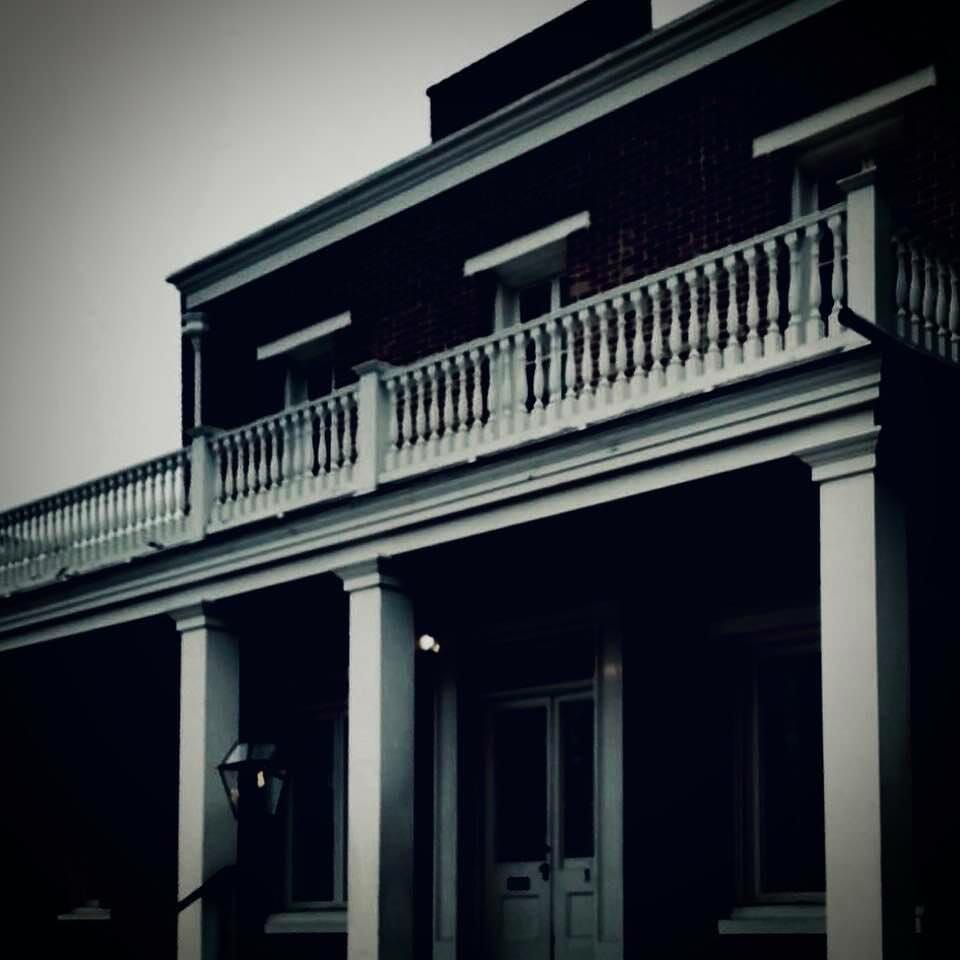 Black and white photo of the Whaley House - spooky looking