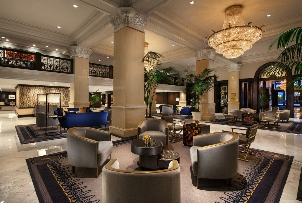 Hotel Lobby of the US Grant Hotel - Luxurious atmosphere with leather chairs, carpets and chandeliers