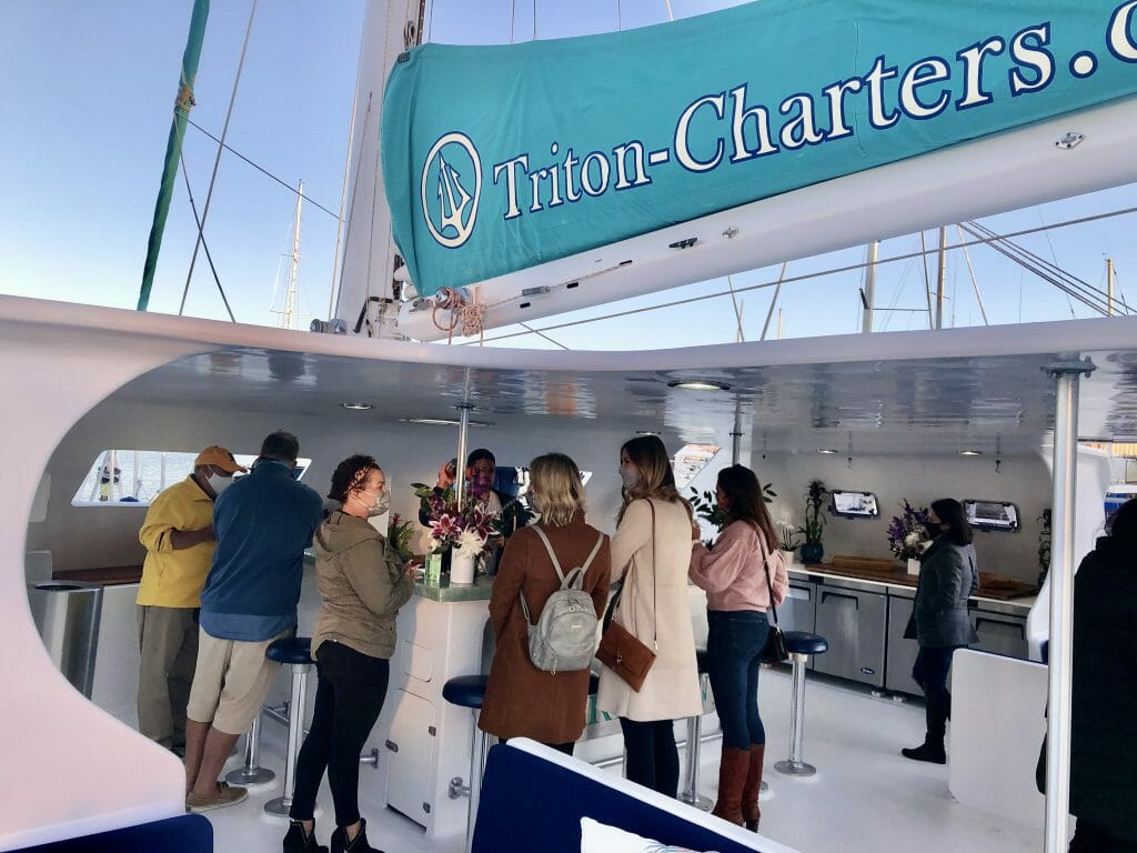Bar on the Triton Catamaran with several people
