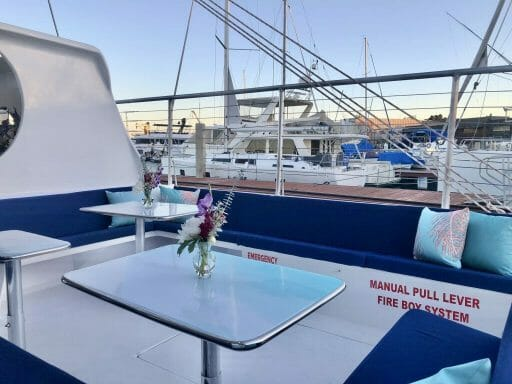 Seating and tables on the San Diego Catamaran Cruise with Triton Charters
