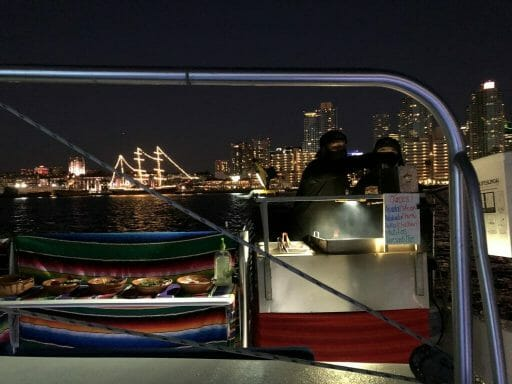 Aldo's Tacos Catering on Board the Triton Sunset Cruise - with San Diego Skyline in the background