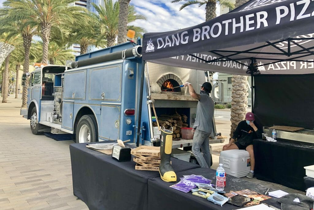 Fire truck remodeled as pizza oven and food truck