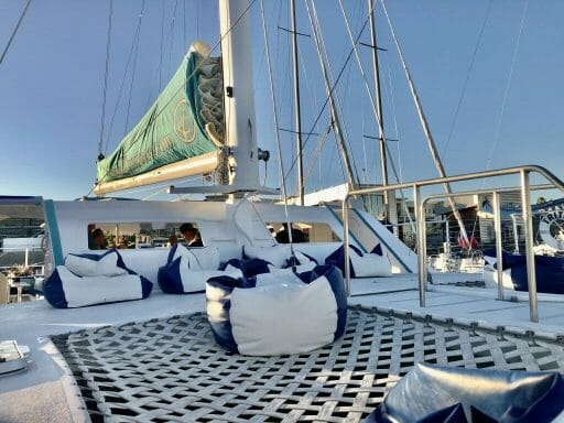 Front hull of Triton Catamaran San Diego with netted floor and blue and white bean bag seats