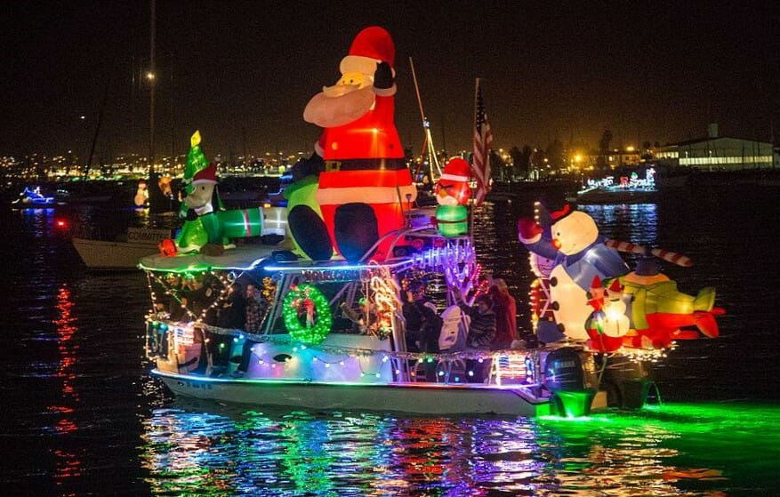 Holiday boat parade in San Diego with boats decorated with Christmas light, Santa Claus and more - Parade of Lights San Diego