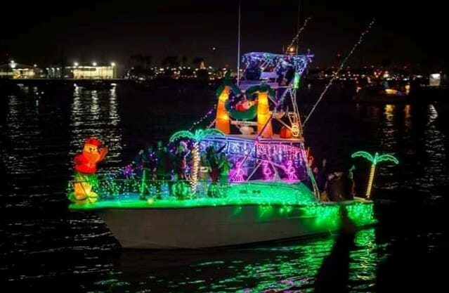 boat decorated with lights and palm trees blow up figures