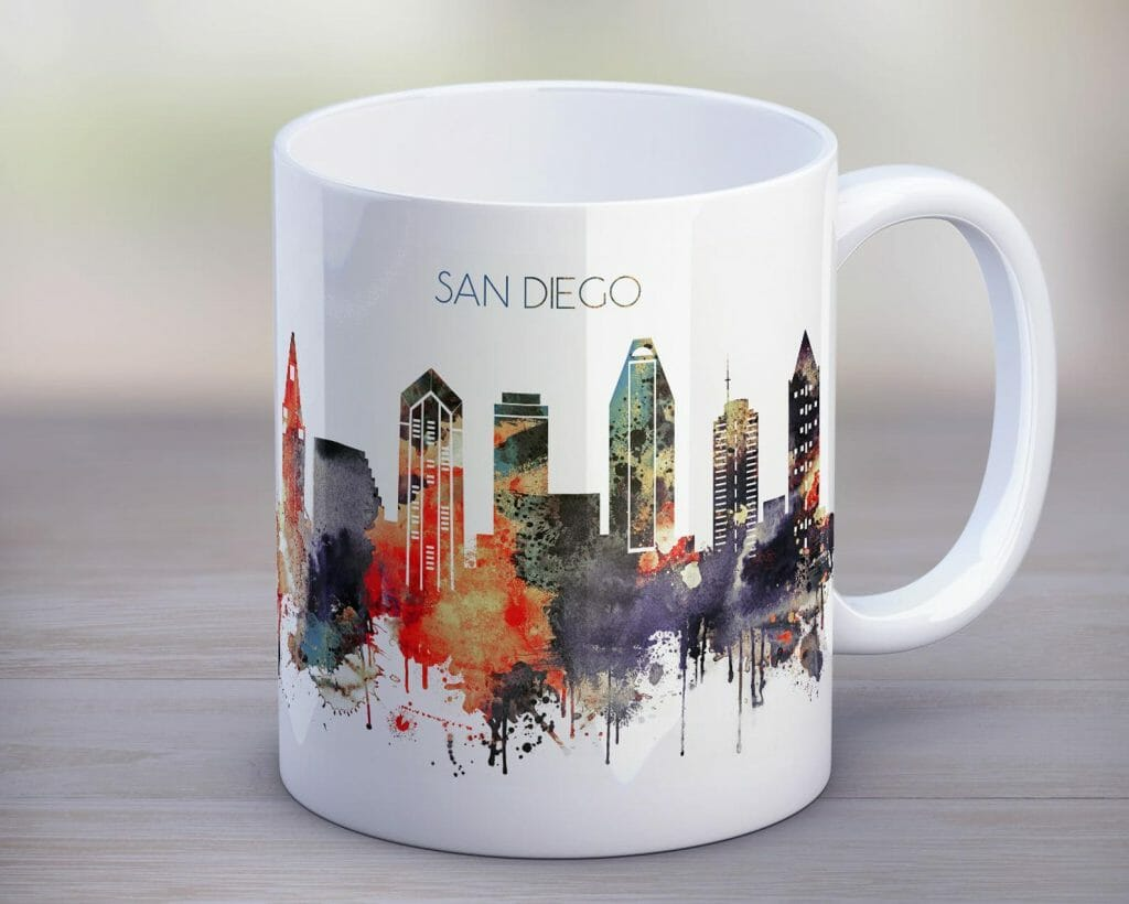 White cup with skyline of san diego in colorful watercolor