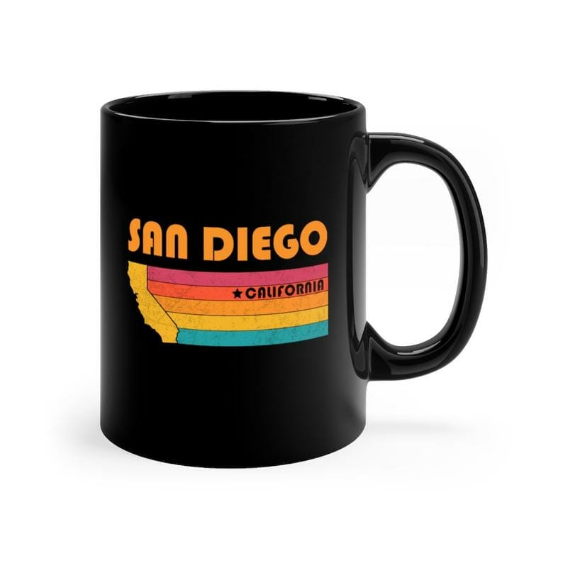 Black cup with Orange text San Diego and outline of California with a rainbow flag