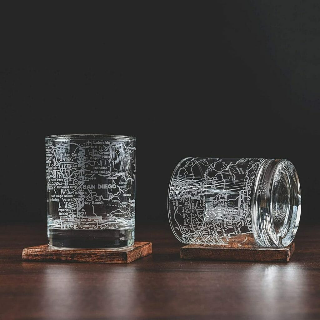 2 Whisky glasses on a table with San Diego map etched into glass in front of a black background