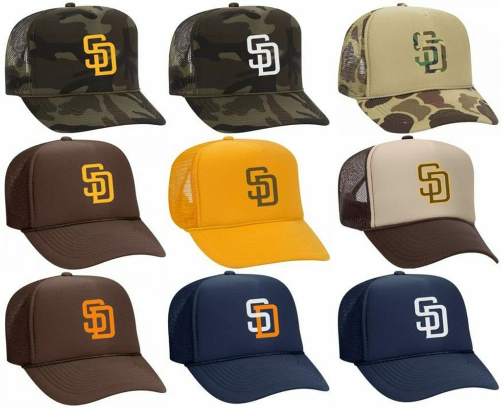 9 baseball hats with San Diego Padres logo in various colors