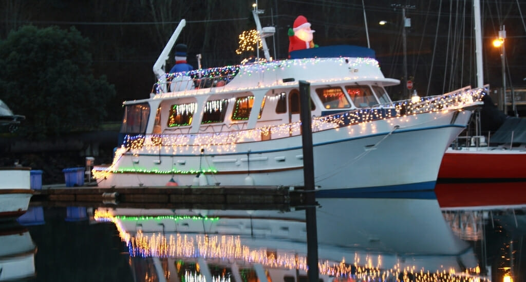 Boat decorated with Christmas lights and santa claus figure