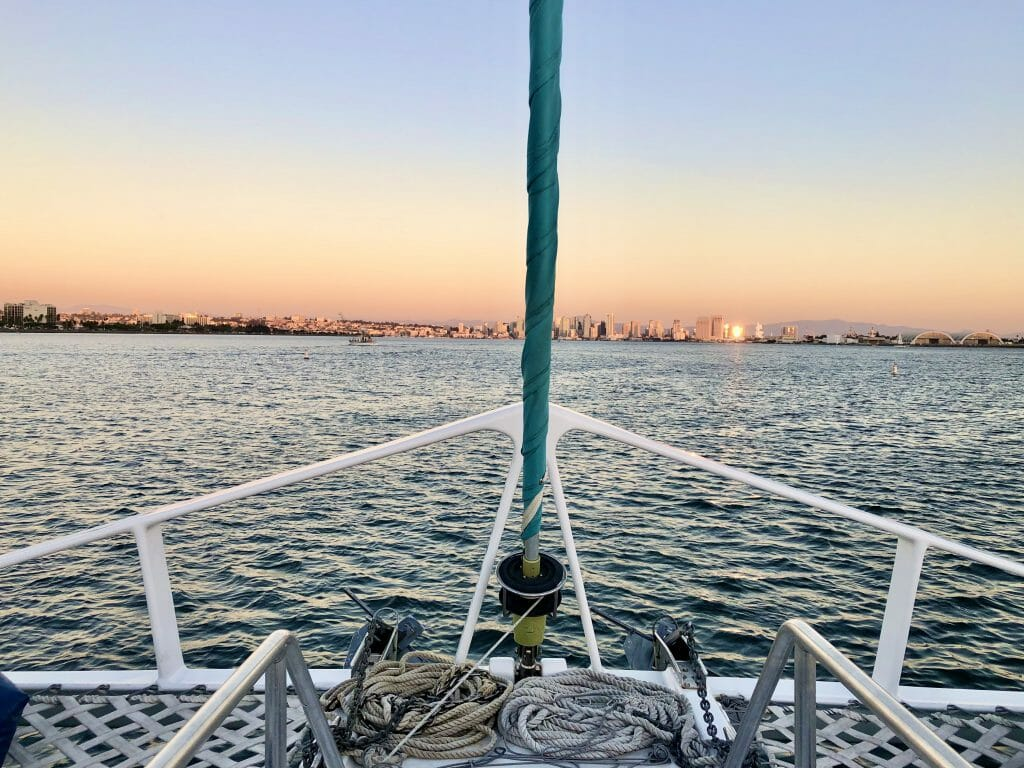 View of the San Diego Skyline during sunset with front of the Catamaran in the foreground