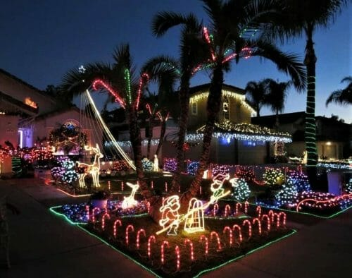 Christmas lights on house and palm trees San Diego: Candy Cane Lane Poway
