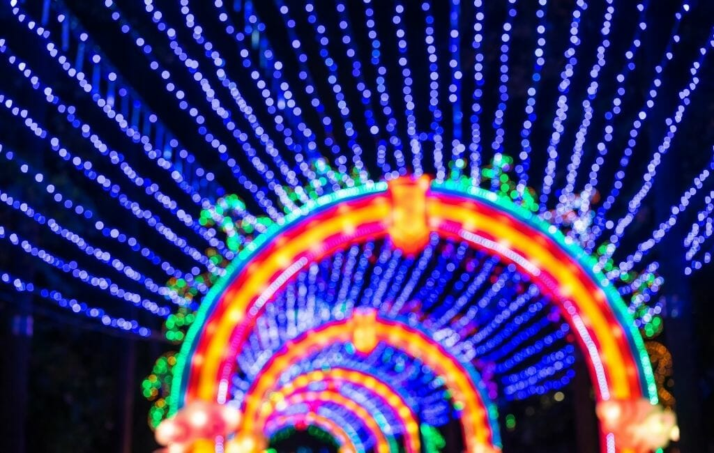Out of focus photo of christmas lights tunnel